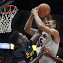 Long Beach State's David Samuels, left, battles for control of the ball over Arizona's Kaleb Tarczewski, right, in the first half of an NCAA college basketball game, Monday, Nov. 11, 2013 in Tucson, Ariz. (AP Photo/John Miller)