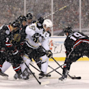 Pittsburgh Penguins center Sidney Crosby (87) works against several Chicago Blackhawks, including Brent Seabrook (7) and Jonathan Toews (19), for control of the puck during the first period of an NHL Stadium Series hockey game at Soldier Field on Saturday