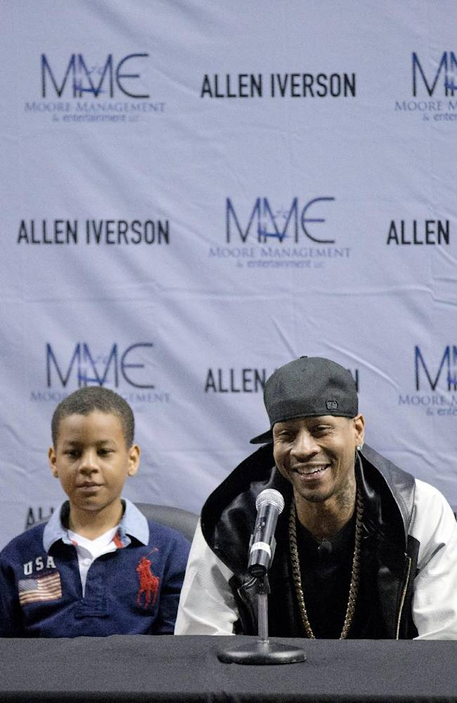 Former Philadelphia 76er Allen Iverson, accompanied by his daughter Tiaura, 18, left, son Isaiah, 7, second from left and daughter Messiah, 10, right, speaks at a news conference Wednesday, Oct. 30, 2013, in Philadelphia. Iverson officially retired from the NBA, ending a 15-year career during which he won the 2001 MVP award and four scoring titles. Iverson retired in Philadelphia where he had his greatest successes and led the franchise to the 2001 NBA finals