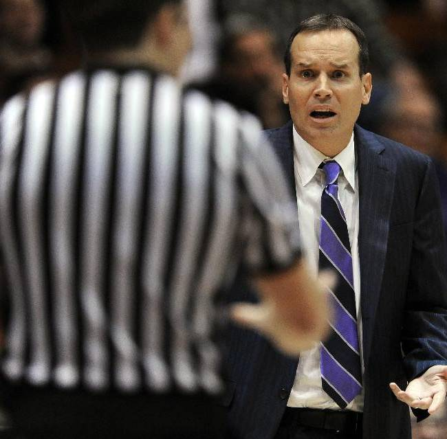 Northwestern head coach Chris Collins, right, reacts to a call during the first half of an NCAA college basketball game against Mississippi Valley State in Evanston, Ill., Monday, Dec. 16, 2013. Northwestern won 86-64