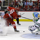 Dallas Stars goalie Kari Lehtonen, of Finland, and Stars' Patrik Nemeth (37), of Sweden, defend Carolina Hurricanes' Riley Nash (20) during the second period of an NHL hockey game in Raleigh, N.C., Thursday, April 3, 2014 The Associated Press