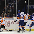 New York Islanders right wing Michael Grabner (40) celebrates left wing Nikolay Kulemin's goal as Philadelphia Flyers goalie Rob Zepp (72) and defenseman Mark Streit (32) react and Islanders center Brock Nelson (29) looks on in the first period of an NHL