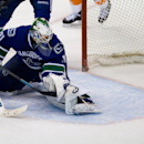 Vancouver Canucks' goalie Eddie Lack, of Sweden, allows a goal to New York Islanders' Matt Martin during third period NHL hockey action in Vancouver, British Columbia, on Monday March 10, 2014 The Associated Press
