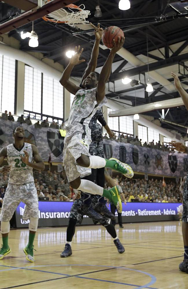 CORRECTS SPELLING OF CITY TO PYEONGTAEK-  Oregon's Damyean Dotson (21) tries to shoot against Georgetown during the first half of an NCAA college basketball game in the Armed Forces Classic at Camp Humphreys in Pyeongtaek, south of Seoul, South Korea, Saturday, Nov. 9, 2013