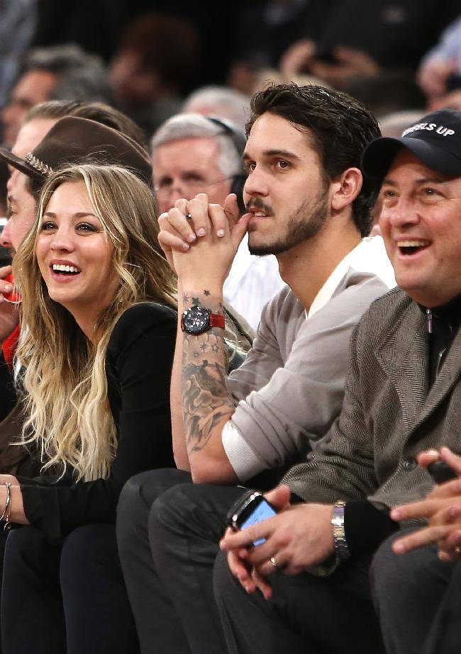 From left, actress Kaley Kuoco, her husband, tennis player Ryan Sweeting, actor Steve Schirripa and Seattle Seahawks quarterback Russell Wilson attend an NBA basketball game between the Dallas Mavericks and the New York Knicks, Monday, Feb. 24, 2014, in New York.  Dallas won 110-108