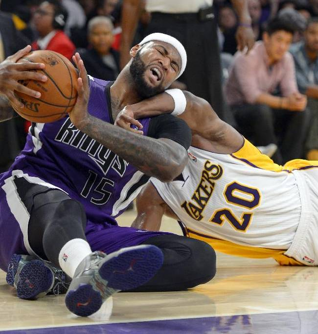 Sacramento Kings center DeMarcus Cousins, left, and Los Angeles Lakers guard Jodie Meeks battle for a loose ball during the second half of an NBA basketball game Sunday, Nov. 24, 2013, in Los Angeles