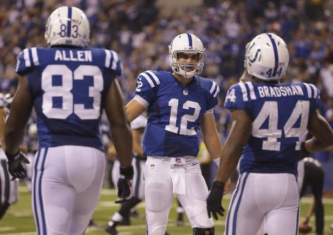 In this Sept. 15, 2014, file photo, Indianapolis Colts' Ahmad Bradshaw (44) is congratulated by quarterback Andrew Luck (12) after scoring on a seven yard touchdown reception during the second half of an NFL football game against the Philadelphia Eagles   in Indianapolis. At left is tight end Dwayne Allen (83). Luck and the Colts are clicking on all cylinders. The running game has produced three straight 100-yard games, and Luck is on pace for the more productive season in Colts history