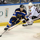 St. Louis Blues' Kevin Shattenkirk (22) skates around Chicago Blackhawks' Bryan Bickell (29) during the second period of an NHL hockey game, Saturday, Oct. 25, 2014, in St. Louis. The Blues won 3-2 The Associated Press