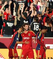 Real Salt Lake midfielder Kyle Beckerman, center, celebrates scoring the first goal of an MLS soccer game against Seattle FC with teammates Javier Morales, left, and Robbie Findley at Rio Tinto Stadium in Sandy, Utah, on Saturday, June 22, 2013. (AP Photo/The Salt Lake Tribune, Kim Raff)