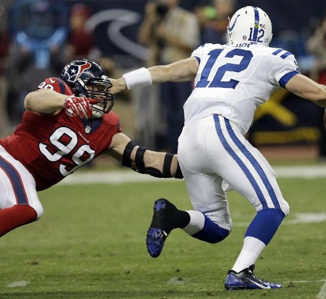 Houston Texans' J.J. Watt (99) pressures Indianapolis Colts' Andrew Luck (12) during the second quarter of an NFL football game Sunday, Nov. 3, 2013, in Houston