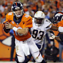 Denver Broncos quarterback Peyton Manning (18) scrambles as San Diego Chargers outside linebacker Dwight Freeney (93) pursues during the second half of an NFL football game, Thursday, Oct. 23, 2014, in Denver The Associated Press