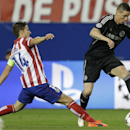 Chelsea's Fernando Torres, right gets past Atletico's Gabi during the Champions League semifinal first leg soccer match between Atletico Madrid and Chelsea at the Vicente Calderon stadium in Madrid, Spain, Tuesday, April 22, 2014