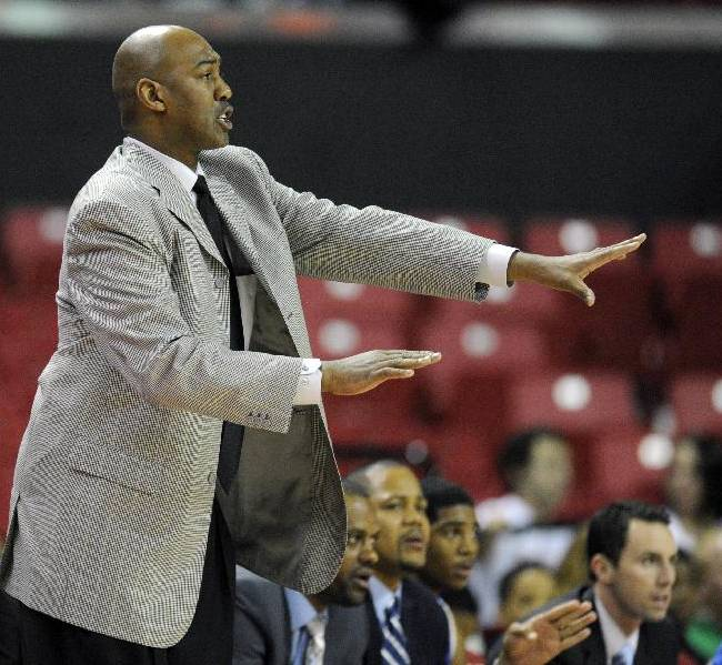 Tulsa head coach Danny Manning signals to his team during the first half of an NCAA college basketball game against Maryland, Sunday, Dec. 29, 2013, in College Park, Md