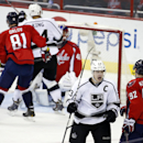 Los Angeles Kings right wing Dustin Brown (23) celebrates his goal in front of Washington Capitals center Evgeny Kuznetsov (92), from Russia, in the third period of an NHL hockey game, Tuesday, March 25, 2014, in Washington. The Kings won 5-4 in a shootou