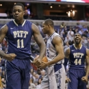Pittsburgh forward Dante Taylor (11) celebrates his shot as forward J.J. Moore (44) smiles, and Georgetown guard Jabril Trawick (55) holds the ball during the first half of an NCAA college basketball game, Tuesday, Jan. 8, 2013, in Washington. (AP Photo/Alex Brandon)