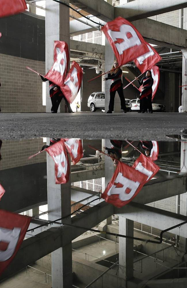 Members of the Rutgers University color guard practice under the stadium before an NCAA college football game against Temple University in Piscataway, N.J. Saturday, Nov. 2, 2013