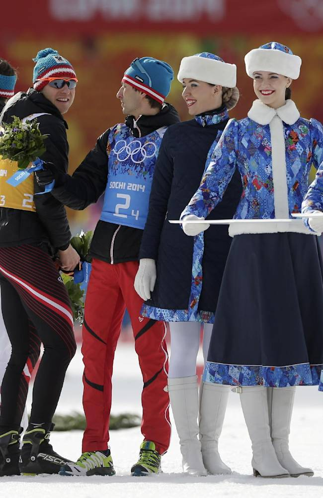 Austria's team Lukas Klapfer, Christoph Bieler, Bernhard Gruber and Mario Stecher, from left, celebrate winning the bronze during the flower ceremony of the Nordic combined Gundersen large hill team competition at the 2014 Winter Olympics, Thursday, Feb. 20, 2014, in Krasnaya Polyana, Russia