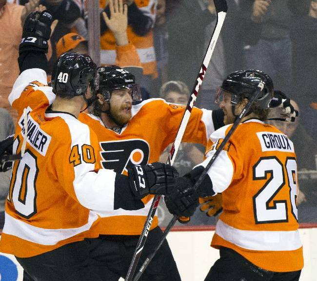Philadelphia Flyers' Jakub Voracek, center, of Czech Republic, celebrates his second goal of the period with Vincent Lecavalier, left, and Claude Giroux, right, during the second period of an NHL hockey game against the Tampa Bay Lightning, Saturday, Jan. 11, 2014, in Philadelphia
