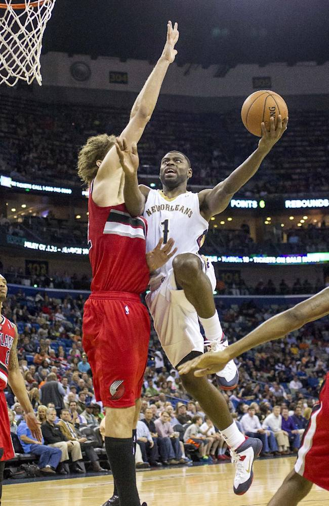 New Orleans Pelicans forward Tyreke Evans (1) scores over Portland Trail Blazers center Robin Lopez (42) in the second half of an NBA basketball game in New Orleans, Friday, March 14, 2014
