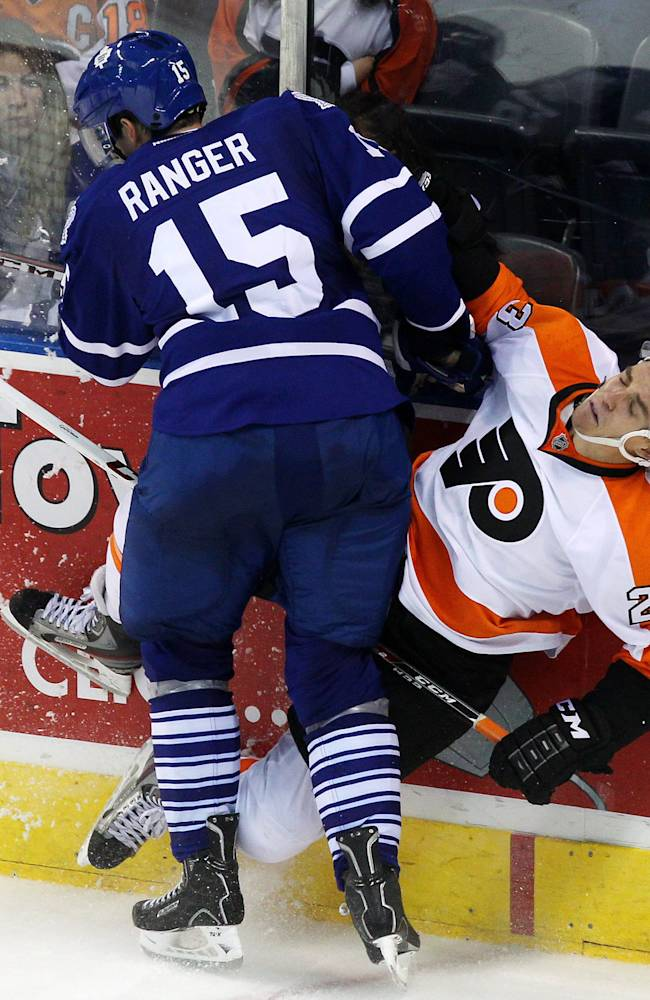 Toronto Maple Leafs' Paul Ranger hits Philadelphia Flyers' Ben Holmstrom into the boards during the third period of an NHL pre-season game, Sunday Sept. 15, 2013 in London, Ontario