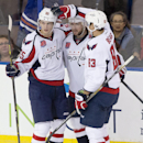 Washington Capitals' Andre Burakovsky (65), Mike Green (52) and Jay Beagle (83) celebrate a goal against the Edmonton Oilers during second-period NHL hockey game action in Edmonton, Alberta, Wednesday, Oct. 22, 2014 The Associated Press