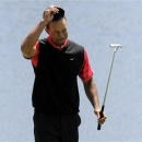 Tiger Woods of the U.S. reacts on the 18th green after he won the Arnold Palmer Invitational PGA golf tournament in Orlando, Florida March 25, 2013. REUTERS/Scott Miller