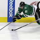 Dallas Stars center Tyler Seguin (91) reaches for the puck against New Jersey Devils right wing Martin Havlat (9) during the third period of an NHL hockey game Saturday, Dec. 13, 2014, in Dallas. The Stars won 4-3 The Associated Press