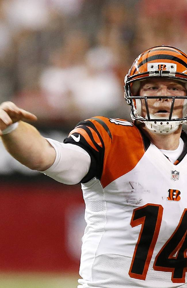 Cincinnati Bengals' Andy Dalton gets off a pass against the Arizona Cardinals during the first half of an NFL preseason football game Sunday, Aug. 24, 2014, in Glendale, Ariz