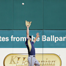 Milwaukee Brewers right fielder Logan Schafer makes a leaping catch to take a hit away from Cleveland Indians' Carlos Santana in the fourth inning of a spring exhibition baseball game Wednesday, March 26, 2014, in Goodyear, Ariz The Associated Press