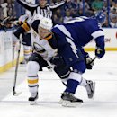Tampa Bay Lightning's Victor Hedman, right, of Sweden, hip-checks Buffalo Sabres' Zemgus Girgensons, of Latvia, during the third period of an NHL hockey game Thursday, Dec. 4, 2014, in Tampa, Fla. The Lightning won 5-0 The Associated Press