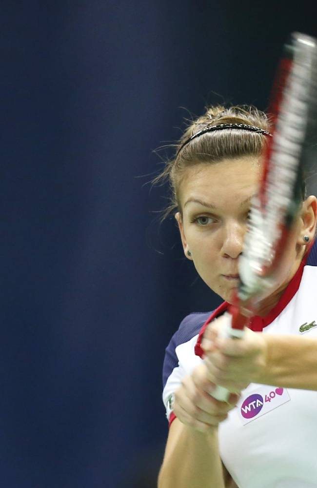 Romania's Simona Halep returns a ball to Russia's Anastasia Pavlyuchenkova during a semi final match at the Kremlin Cup tennis tournament in Moscow, Russia, Saturday, Oct. 19, 2013