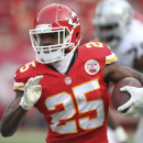 Kansas City Chiefs running back Jamaal Charles (25) carries the ball during the first half of an NFL football game against the Oakland Raiders in Kansas City, Mo., Sunday, Dec. 14, 2014 The Associated Press