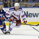 New York Islanders center Anders Lee (27) defends New York Rangers defenseman Dan Boyle (22) in the third period of an NHL hockey game in Uniondale, Tuesday, Jan. 27, 2015. The Islanders defeated the Rangers 4-1 The Associated Press