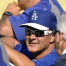 Los Angeles Dodgers manager Don Mattingly looks on during batting practice before a baseball game against the St. Louis Cardinals, Friday, May 24, 2013, in Los Angeles.  (AP Photo/Mark J. Terrill)