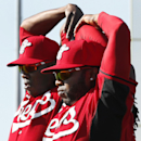 Cincinnati Reds pitchers Aroldis Chapman, left, and Johnny Cueto loosen up during spring training baseball practice in Goodyear, Ariz., Saturday, Feb. 15, 2014 The Associated Press
