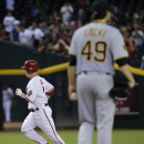 Marte, Hill lift Diamondbacks past Pirates, 7-4 The Associated Press