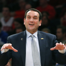 Duke head coach Mike Krzyzewski gestures to his players in the first half of an NCAA college basketball game against St. John's at Madison Square Garden in New York, Sunday, Jan. 25, 2015. Coach Krzyzewski is going for his 1,000th win. (AP Photo/Kathy Willens)