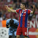 Bayern's Robert Lewandowski reacts during the Champions League Group E soccer match between FC Bayern Munich and Manchester City at Allianz Arena in Munich, southern Germany, Wednesday Sept. 17, 2014