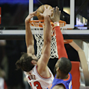 Chicago Bulls center Joakim Noah (13) dunks against Detroit Pistons forward Greg Monroe (10) during the first half of an NBA basketball game in Chicago on Friday, April 11, 2014 The Associated Press