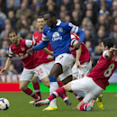 Everton's Romelu Lukaku, centre, keeps the ball from Arsenal's Mikel Arteta, right, as Mathieu Flamini, left, looks on during their English Premier League soccer match at Goodison Park Stadium, Liverpool, England, Sunday, April 6, 2014