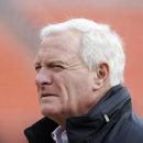 FILE - In this Nov. 2, 2014 file photo, Cleveland Browns owner Jimmy Haslam watches warmups before an NFL football game against the Tampa Bay Buccaneers in Cleveland. Haslam has no plans to fire general manager Ray Farmer, who is at the center of a texting investigation by the NFL. The league has yet to announce any punishments. (AP Photo/Tony Dejak, File)