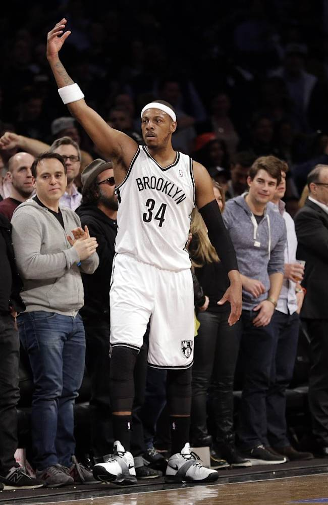 Brooklyn Nets' Paul Pierce (34) gestures to the crowd during the first half of Game 3 of an NBA basketball first-round playoff series against the Toronto Raptors on Friday, April 25, 2014, in New York