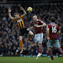 West Ham's James Collins, center, competes for the ball with Hull City's Stephen Quinn during the English Premier League soccer match between West Ham and Hull City at Upton Park stadium in London, Sunday, Jan. 18, 2015