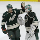 Minnesota Wild defenseman Ryan Suter (20) congratulates Minnesota Wild goalie Josh Harding (37) after the Wild beat the Blackhawks 4-3 during an NHL hockey game in St. Paul, Minn., Thursday, Dec. 5, 2013 The Associated Press
