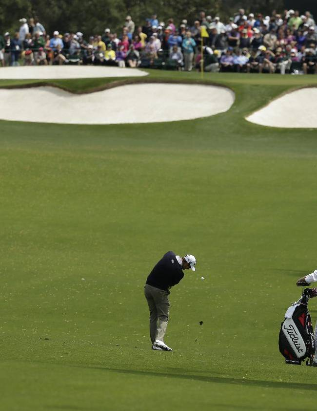 Adam Scott, of Australia, hits to the seventh fairway during a practice round for the Masters golf tournament Tuesday, April 8, 2014, in Augusta, Ga