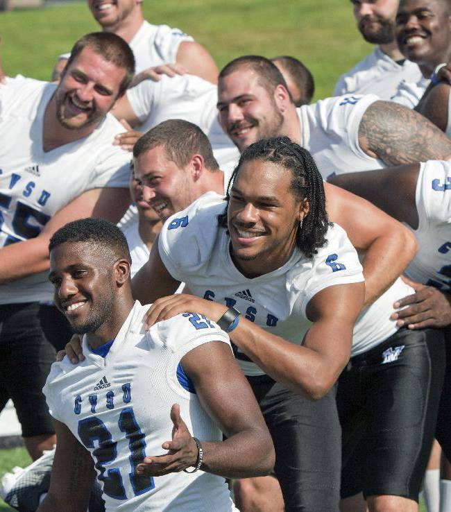 Players pose for a picture during Grand Valley State University college football media day at Lubbers Stadium in Allendale Township, Mich., Wednesday, Aug. 20, 2014