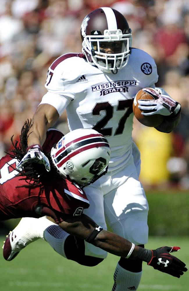 Mississippi State running back LaDarius Perkins (27) runs the ball as South Carolina linebacker Sharrod Golightly (9) defends during the first half of an NCAA college football game, Saturday, Nov. 2, 2013, in Columbia, S.C