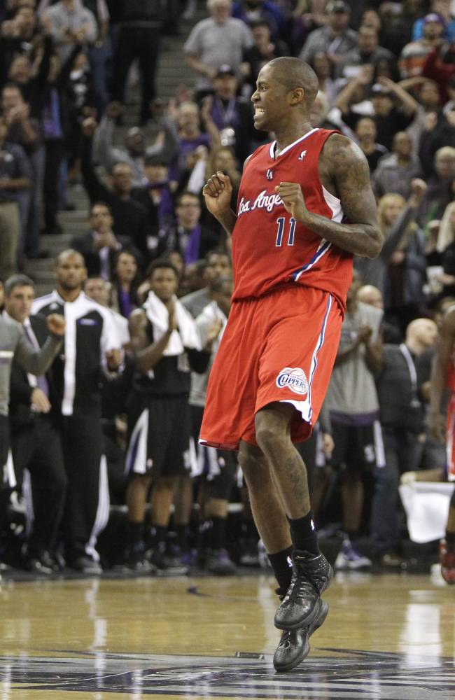 Los Angeles Clippers guard Jamal Crawford grimaces after missing a shot at the end of regulation against the Sacramento Kings in an NBA basketball game in Sacramento, Calif., Friday, Nov. 29, 2013. The Clippers won in overtime, 104-98