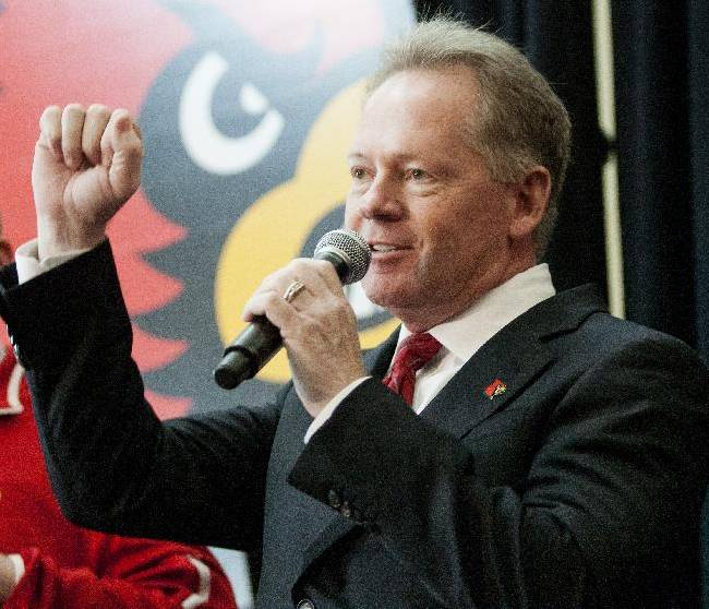 Bobby Petrino cheers 'Go Cards' while greeting fans after being announced as the new University of Louisville football coach at Papa John's Cardinal Stadium, Thursday, Jan. 9, 2014, in Louisville, Ky