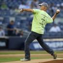 Former Navy officer Richard Albero, of Dunedin, Fla., who walked 1,150 miles from George M. Steinbrenner Field in Tampa, Fla. to Yankee Stadium, throws out the ceremonial first pitch after concluding his journey, before a baseball game between the New York Yankees and the Kansas City Royals in New York, Tuesday, May 26, 2015. Albero made the trip to honor his nephew who died in the Sept. 11 World Trade Center attacks and to raise money for the Wounded Warrior Project. (AP Photo/Kathy Willens)
